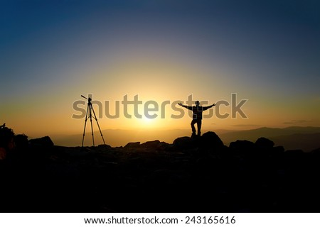 Cameraman on a mountain - stock photo