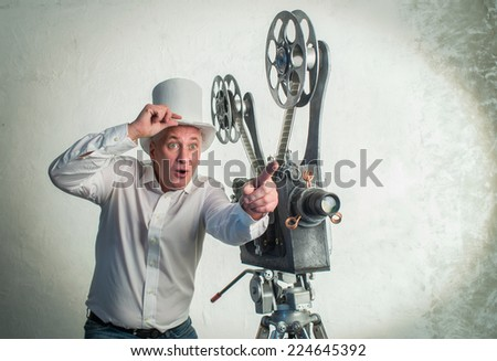 Cameraman with with a film projection - stock photo