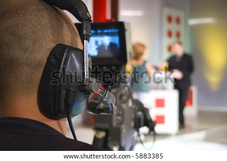 Cameraman works in the studio - recording show in TV studio - stock photo