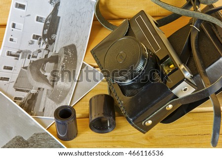 Cameras, film, photo album and on the surface of wood