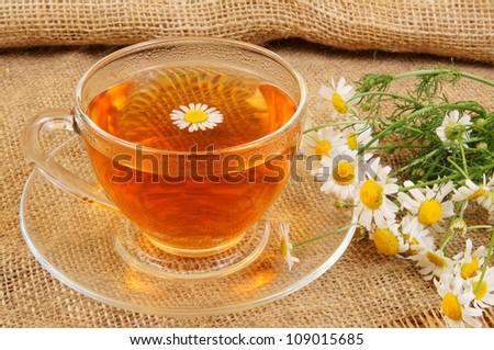 stock-photo-camomile-tea-on-jute-sack-ba