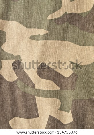Camouflage fabric texture used as background - stock photo