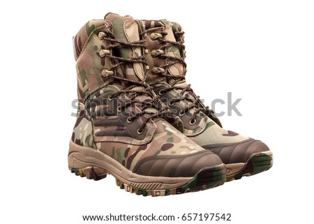 Camouflage military boots isolated on white background