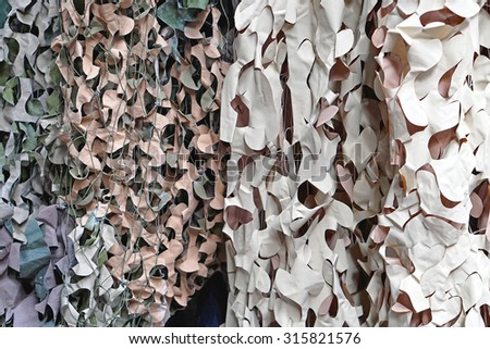 Camouflage net for hidding in nature - stock photo