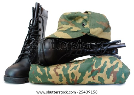 Camouflage uniform and two black leather army boots on isolated (white) background. - stock photo