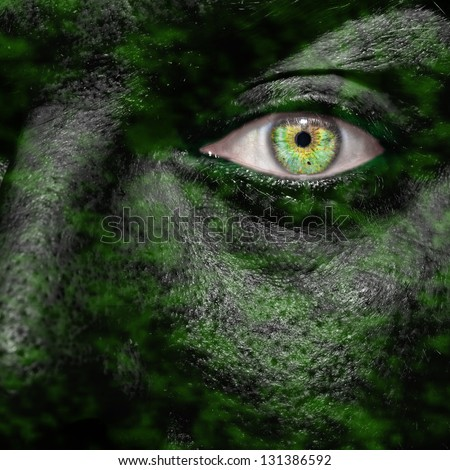 Camouflaged face of a commando soldier - stock photo