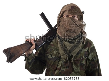 Camouflaged guerrilla soldier with hidden face and a machine gun. Isolated on white background. - stock photo