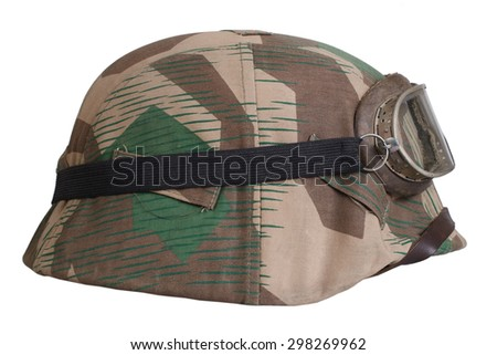 camouflaged nazi german helmet with protective goggles isolated - stock photo