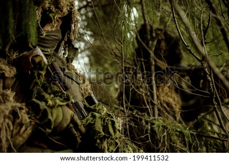 Camouflaged snipers. Soldiers dressed in ghillie camouflage on nature. Conduct surveillance. - stock photo