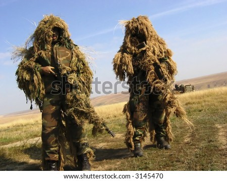 Camouflaged Soldier Aiming. Sniper. Army - stock photo