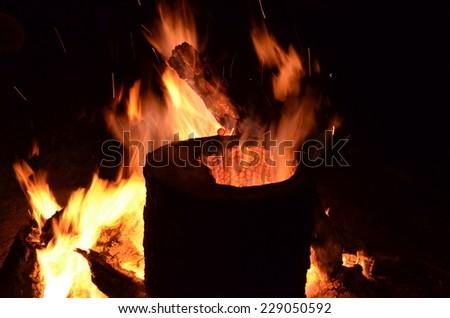 Camp fire on a dark night - stock photo