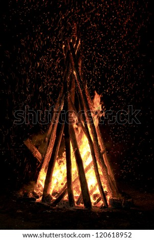 camp fire stack in the night - stock photo