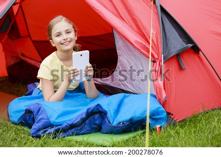 Camp in the tent - young girl on the camping - stock photo