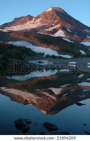 Camp Lake beneath South Sister Mountain, Oregon - stock photo