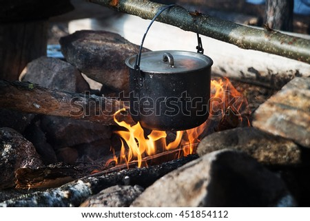 Campaign pot and fire, tourism, travelling
