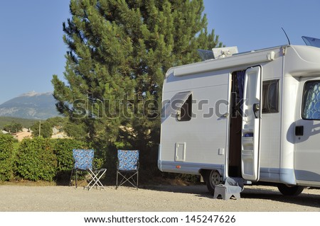 Camper at campersite at Vaison-la-Romaine with view at the Mont Ventoux - stock photo