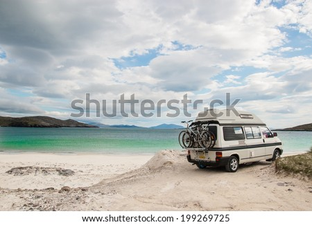 Camper van parked on a beach in the Isle of Lewis, Outer Hebrides, Scotland, UK.