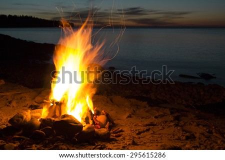 Campfire burning in the dark romantic night