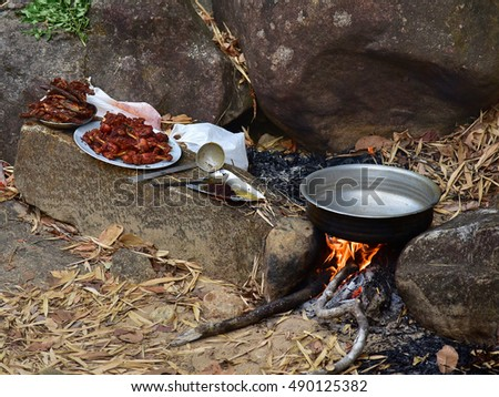 Campfire Cooking Chicken And Fish Out In The Open An Aluminium Vessel