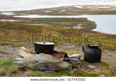 Campfire cooking in Swedish Lapland. - stock photo