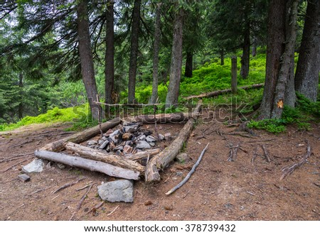 Campfire in the wood, Carpathians - stock photo