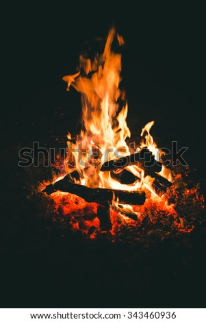 Campfire on the nature. Rest near the fire camp. - stock photo
