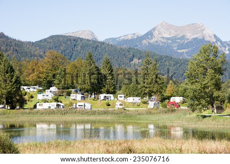 Campground in the Karwendel mountains of the alps. - stock photo