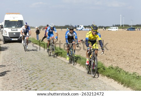 CAMPHIN EN PEVELE,FRANCE-APR 13:The Slovak cyclist Michal Kolar from Tinkoff-Saxo Team riding on the cobblestone sector Carrefour de Arbre in Camphin-en-Pevele on April 13 2014 during Paris-Roubaix  - stock photo