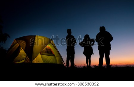 camping and sunset. - stock photo