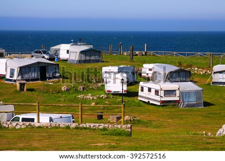 Camping at sea coast in  summer day - stock photo