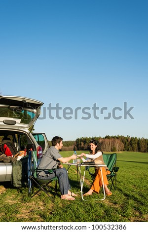 Camping car happy young couple enjoy picnic sunny countryside - stock photo