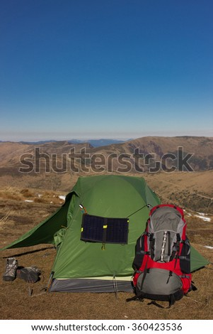 Camping elements equipment on top of the mountain. - stock photo