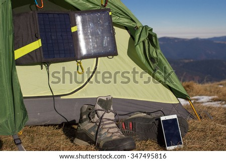 Camping equipment in the mountains. - stock photo