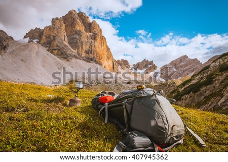 Camping gas and  backpack on Alps background - stock photo