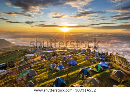 Camping in high mountains in the morning - stock photo