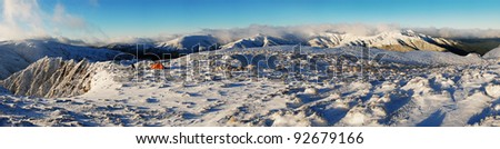 camping in snowy mountains - stock photo