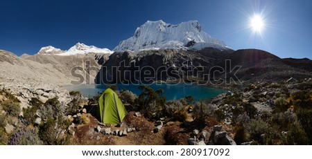 Camping in spectacular high mountains, Cordillera Blanca, Andes, Peru, panorama image - stock photo