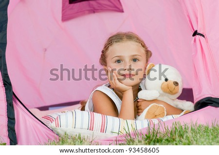 Camping in tent - cute girl on camp tent - stock photo