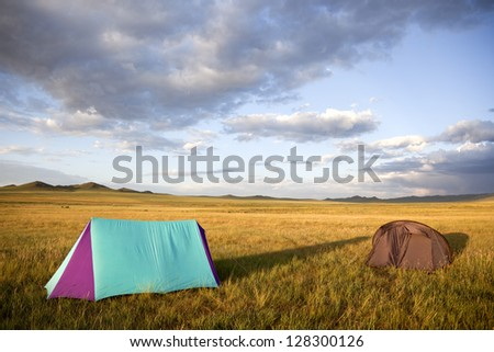 Camping in the Gobi desert at sunset creating shadows lengthened. - stock photo