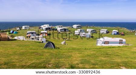 Camping near sea  in sunny summer day - stock photo