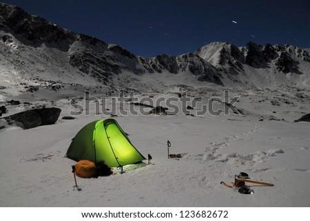 Camping on the snow, Retezat mountains, Romania - stock photo