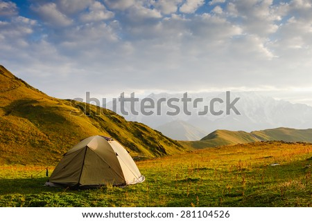 Camping tent in a morning light. Caucasus. Georgia - stock photo