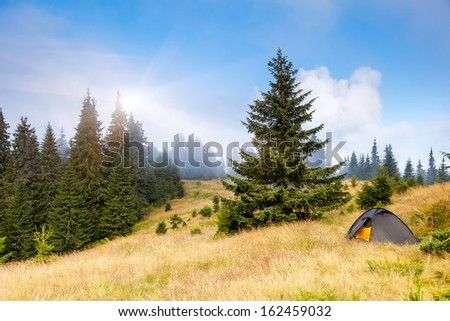 Camping tent in a mountain environment. Carpathian, Ukraine, Europe. Beauty world. - stock photo
