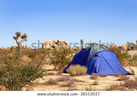 Camping tent set up in the Mojave Desert. - stock photo