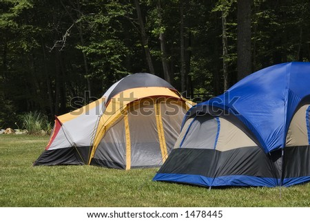 Camping Tents in the Mountains - stock photo