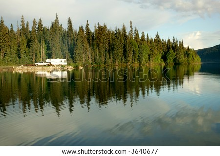 Camping with RV trailer on Meziadin Lake, British Columbia, Canada - stock photo
