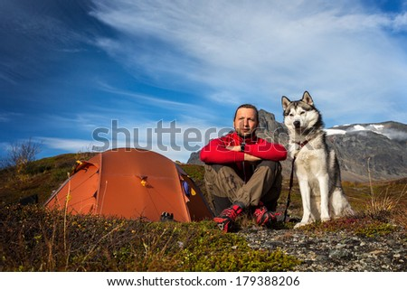 Camping with siberian husky - stock photo