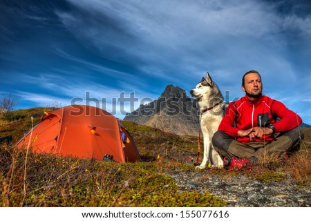 Camping with Siberian Husky in Lapland - stock photo