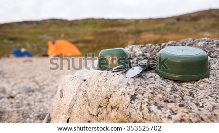 Campside in the wilderness with dishes - stock photo
