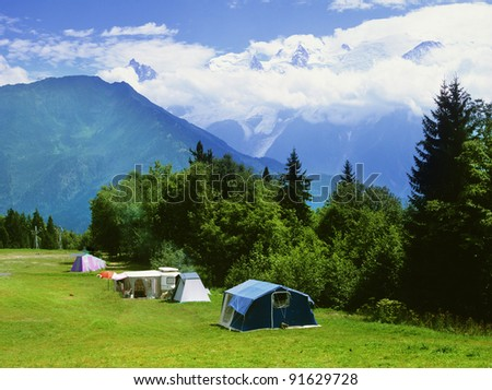 campsite beneath Mont Blanc the highest mountain in france and europe. The french alps. - stock photo